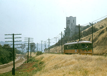 Gold line rail car going past the Southwest Museum, early 1950s