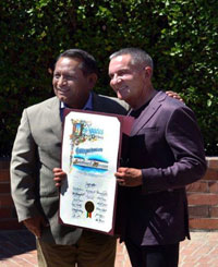 Councilmember Gil Cedillo presents a certificate to CEO Rick West